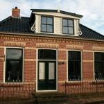 Schilderen en restaureren dakkapel en voorgevel